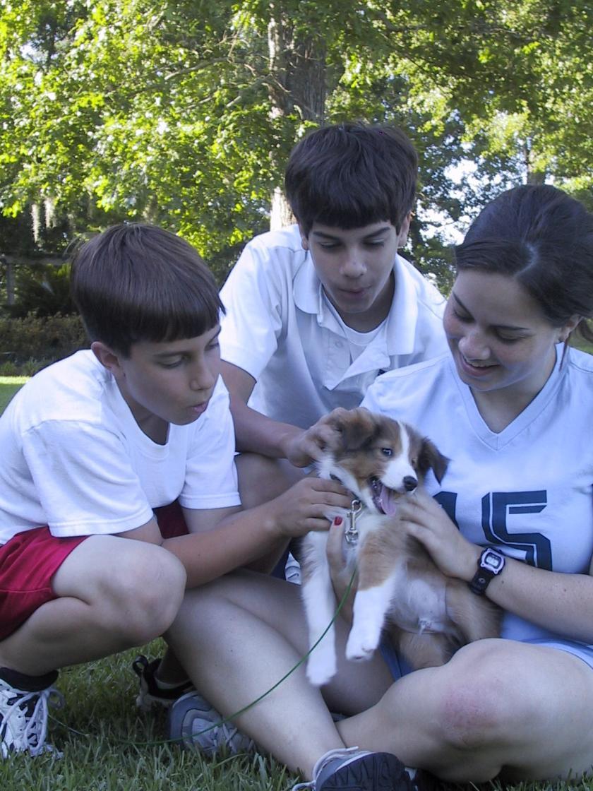 Sean Aguiar, 11, Nathan Aguiar, 13, Rachel Aguiar, 16, and Bernie the dog in Baton Rouge, Louisiana.