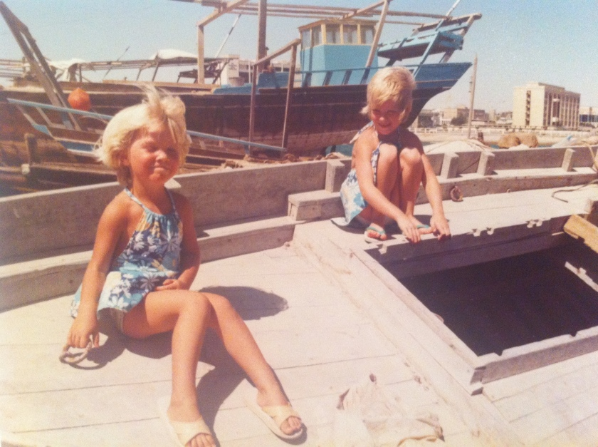 Sarah Emberson and her sister Vicki sit on a traditional Arab Dhow in Doha, Qatar.